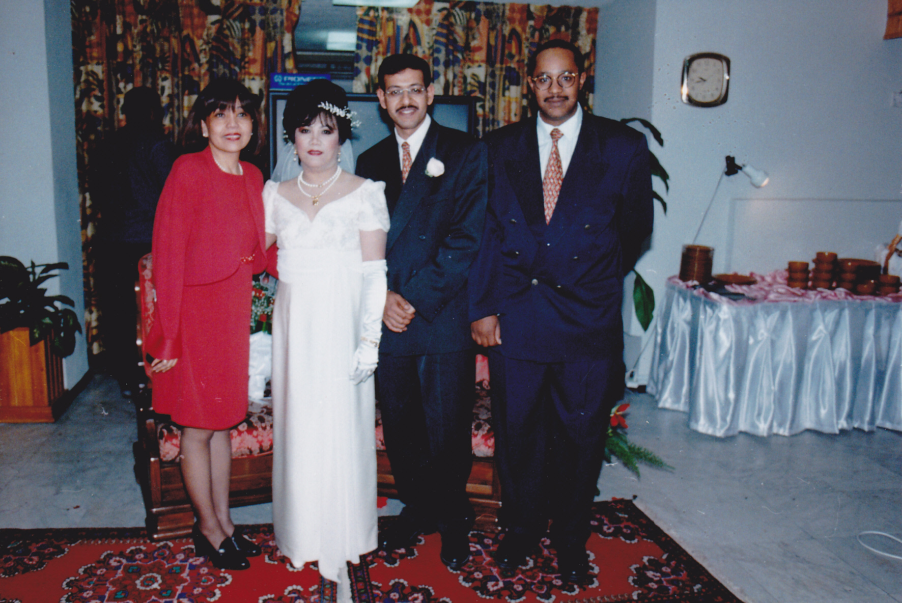 Ofie was the emcee during a brief program which commenced after I arrived. I actually arrived with her, bringing with us, staright from her place, the two red sofas Waleed and I sat on. This was during the celebration of my wedding to Waleed held February 16, 1997.