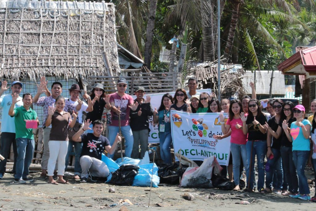 Employees of the Provincial Government of Antique, as they pose for a souvenir shot and after they have cleaned one coastal Barangay in San Jose, capital town of Antique.