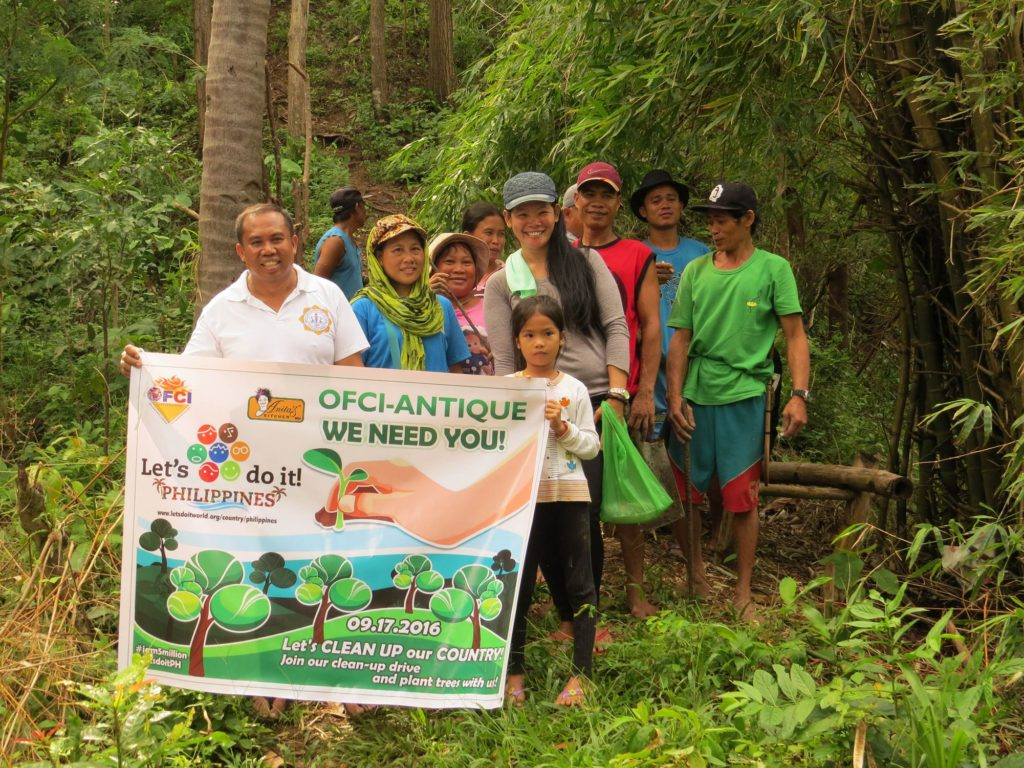 Principal Alfredo Montalban of Mapatag Elementary School is seen leading the teachers and pupils for a tree planting activity today at the Mapatag Tree Park